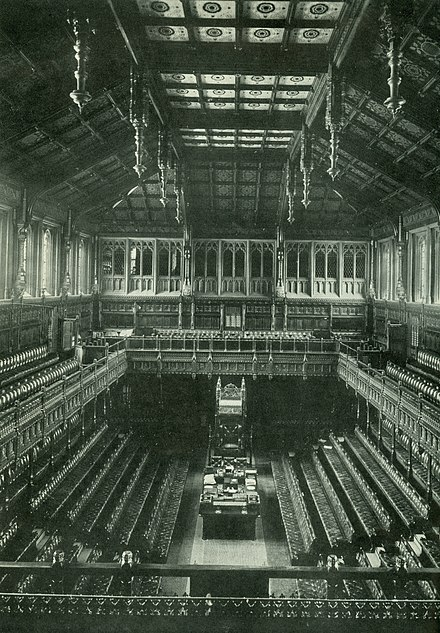 The old House of Commons chamber, showing dark veneer on the wood, which was purposely made much brighter in the new chamber. Old House of Commons.jpg