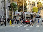 Outbound N Judah train with alighting passengers at Carl and Cole, September 2017.JPG