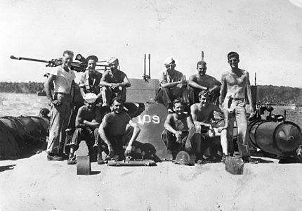 PC 100 Lt. (jg) John F. Kennedy and crewmen of the PT 109. Solomon Islands, 1943.jpg