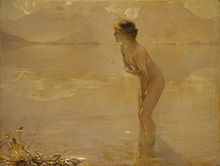 A nude woman standing on a beach