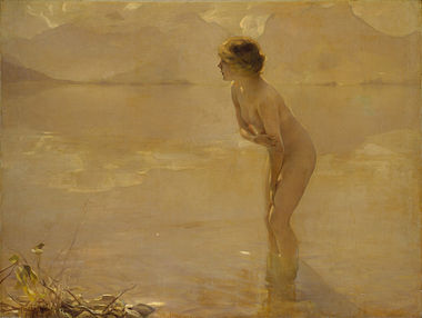 A nude woman standing along the beach