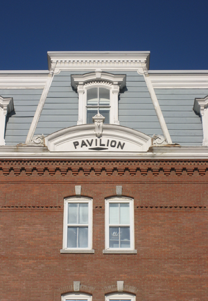 The Pavilion (Vermont) - Detail of the mansard roof showing the Pavilion's nameplate.