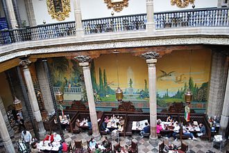 Casa de los Azulejos - The peacock mural side of the courtyard.
