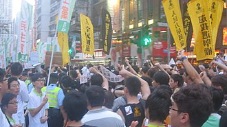 People Power (Hong Kong) - In 2011, members and supporters of People Power denounce the Democratic Party during the 1 July march