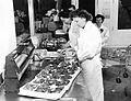 People packaging meat at Bergs Supermarket, circa 1950 (6327551672).jpg