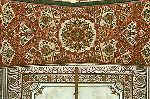 Mahabat Khan Mosque - The mosque's ceiling is embellished with elegant red frescoes in geometrics and floral motifs.