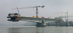 The Pierre Pflimlin bridge is a balanced cantilever made of concrete, shown here under construction.