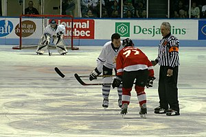 Pierre Turgeon - Mario Lemieux and Pierre Turgeon on a faceoff at the Legends Game for the 50th edition of the Quebec International Pee-Wee Tournament