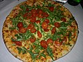 Pizza with rucola and tomatoes.jpg