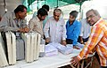 Polling officials collecting the Electronic Voting Machines (EVM's) and other necessary inputs required for the General Elections-2014, at the distribution centre, at Lal Pared Ground, in Bhopal on April 16, 2014.jpg