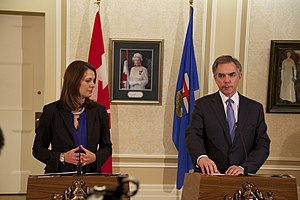 Jim Prentice - Prentice and Danielle Smith announcing that Smith and eight other Wildrose MLAs would be crossing the floor to join the Progressive Conservatives
