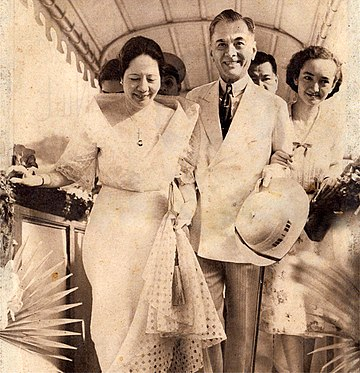 "President Quezon with his wife Aurora (left) and daughter Maria Aurora ""Baby"" (right) in 1938 President Manuel L. Quezon with Aurora and Baby Quezon in 1938.jpg"