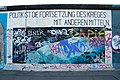 Quote on war and politics on the Berlin Wall.jpg