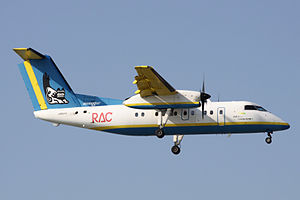 Ryukyu Air Commuter - A RAC Bombardier Dash 8 Q300 in the old livery, landing at Naha Airport, Okinawa Prefecture, Japan. (2009)