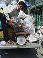 Recycler buying trash from door to door - Thailand.JPG