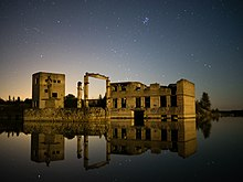 Remains of Rummu quarry utility buildings in the water at night on 5 September 2014.jpg