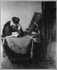 Young scholar reading in a study