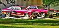 Restored Antique Cars in a Yard (15439557767).jpg
