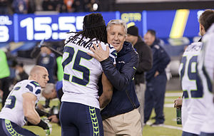 Super Bowl XLVIII - Richard Sherman and Pete Carroll embracing at Super Bowl XLVIII