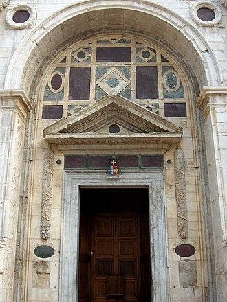 Tempio Malatestiano - Doorway of the Malatesta Temple by Leon Battista Alberti.