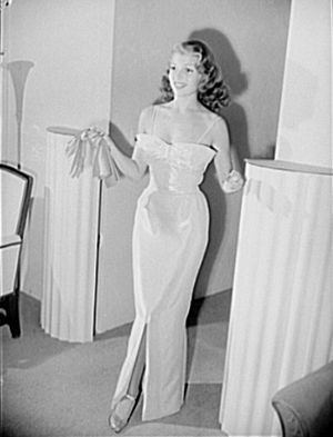 Howard Greer - Actress Rita Hayworth models a pink and silver lamé evening gown designed by Howard Greer, 1941.