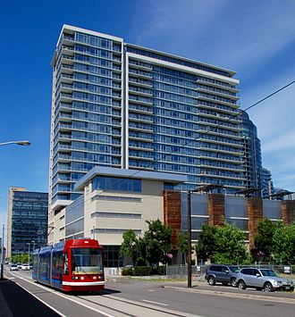 South Waterfront - Public transit in the district includes the Portland Streetcar, seen here passing Riva on the Park.
