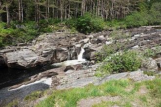 Pothole (landform) - River Orchy, Scotland, showing erosion potholes in bedrock