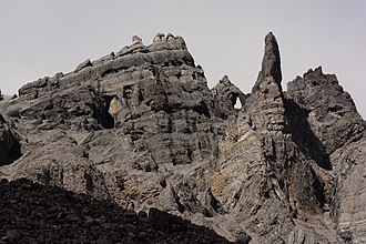 Gates of the Arctic National Park and Preserve - Ancient seabed formations have weathered into cliffs, fins, pinnacles, and arches.