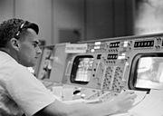 Roger B. Chaffee at a console in the Mission Control Center, Houston, during the Gemini-Titan 3 flight