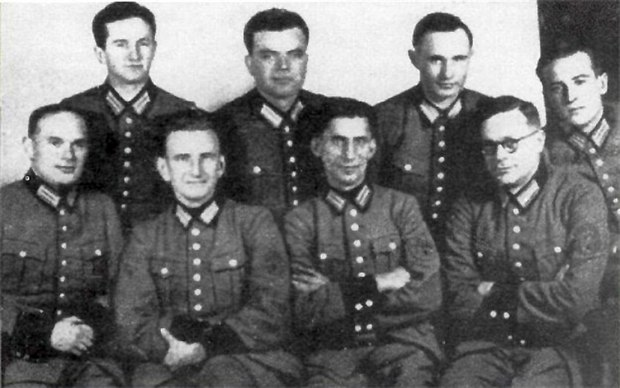 Schutzmannschaft Battalion 201 leaders, with Roman Shukhevych (sitting, second from left), 1942 Roman Shukhevych - Bataillon 201 (1942).jpg