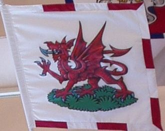 Rouge Dragon Pursuivant - The badge as displayed on a banner hanging in the College of Arms.