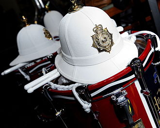 Royal Marines Band Service - Helmets and drums of the Royal Marines Band Service.