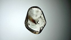 Rutilated Quartz Specimen 1 - very rare formation of meteor-like cluster of rutile strands.jpg