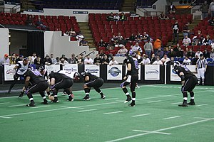 Chicago Knights - Quarterback Ryan Maiuri taking a snap against the Chicago Slaughter in 2008.