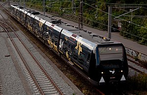 Natteravnene - S-train in Denmark with a sponsored wrap advertisement for Natteravnene in Denmark