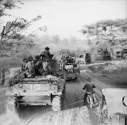 Sherman tanks and trucks advancing on Meiktila, March 1945.