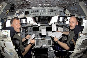 STS-108 Dominic Gorie and Mark Kelly in Endeavour's cockpit
