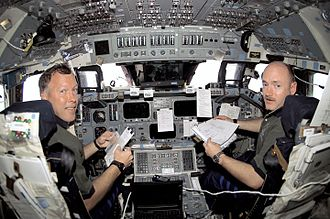 Mark Kelly -   STS-108 Commander Dominic L. Gorie and Pilot Mark Kelly, in their stations during rendezvous operations with the International Space Station.