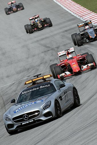Mercedes-AMG GT safety car leading the field around the circuit at reduced speed Safety Car with Sebastian Vettel 2015 Malaysia.jpg