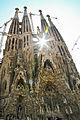 Sagrada Familia with sun peaking through.jpg
