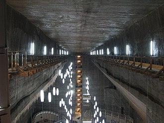 Salina Turda - The main hall with salt stalactites on the left side