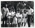 Sam Jones and Satch Sanders of the Boston Celtics pose with girls holding basketball trophies (13561741474).jpg