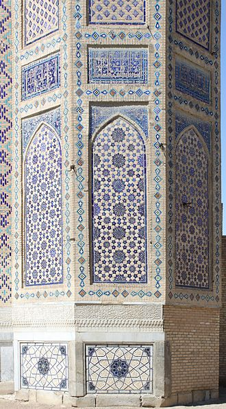 Islamic geometric patterns - Detail of minaret socle of the Bibi Khanum Mosque, Samarkand, Uzbekistan. The arched vertical panels are decorated with different geometric patterns, featuring 10-, 8- and 5-pointed stars.