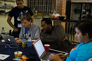 A Foundation staffer and new participants collaborate at the hackathon