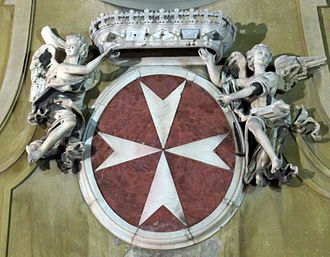 Coat of arms of the Knights of Malta from the facade of the church of San Giovannino dei Cavalieri, Florence, Italy San Giovannino dei Cavalieri stemma Cavalieri di Malta.JPG