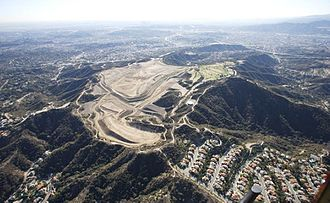 Scholl Canyon Landfill - Southwest view of Glendale's Scholl Canyon Landfill in the San Rafael Hills. Active landfill predominates, small golf course to right.