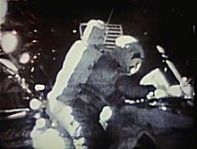 Image taken on the Moon showing an astronaut canceling an envelope (due to the poor quality, the envelope cannot be seen)