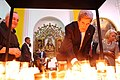 Secretary Kerry Lights a Prayer Candle.jpg