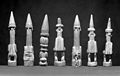 Seven carved wood statues representing Oma, a household god Wellcome M0019325EC.jpg