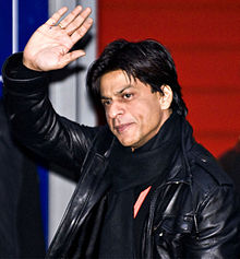 Shah Rukh Khan waving to fans at a film festival